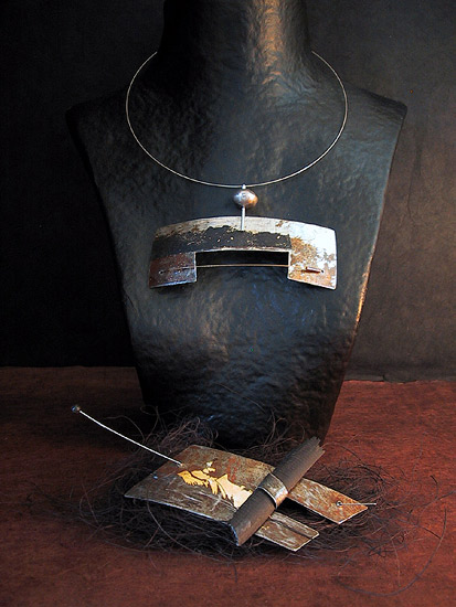 Necklace and brooch: recycled metal oxidized patinated with gold leaf Joyas