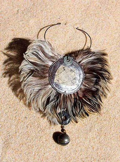 Bib feather necklace with an african bronze  bell Joyas