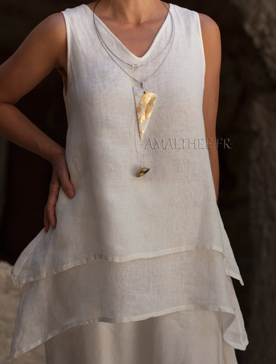 Contemporary mother of pearl pendant patinated with gold leaf Joyas